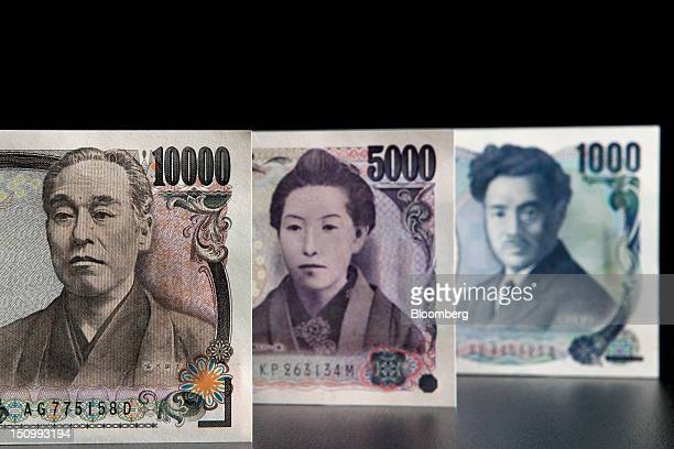 Japanese yen banknotes of various denominations are arranged for a photograph in Soka City Saitama Prefecture Japan on Wednesday Aug 29 2012 The...