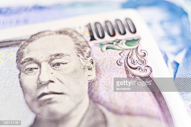 japanese yen banknotes - japanese yen note stock photos and pictures