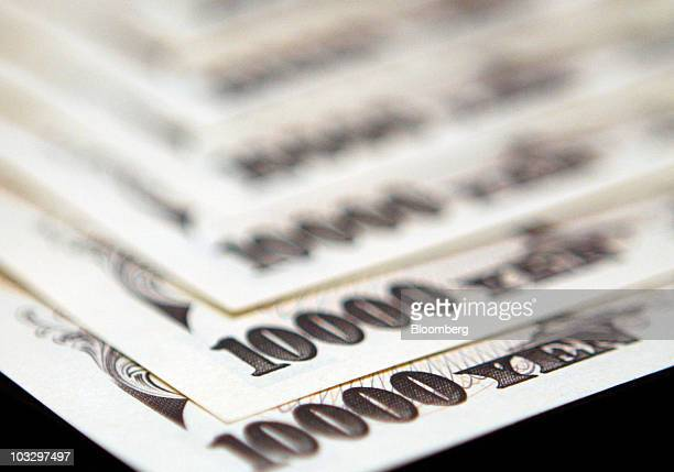 Japanese yen notes are arranged for a photograph in Tokyo Japan on Monday Aug 9 2010 The yen traded near an eightmonth high against the dollar as...