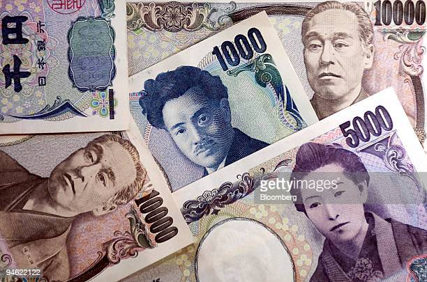 Japanese yen notes are arranged for a photograph in Tokyo Japan on Monday Sept 24 2007 The yen rose for a third day against the dollar its longest...