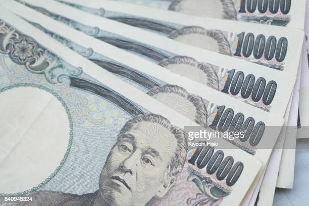10000 japanese yen notes - japanese yen note stock photos and pictures