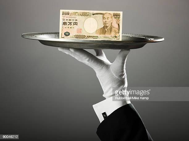 japanese yen on a platter