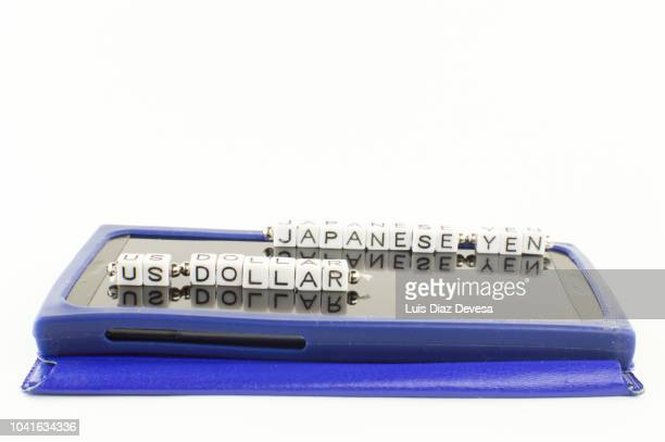 japanese yen (jpy)  to  dollar (usd) currency converter - japanese yen note stock photos and pictures