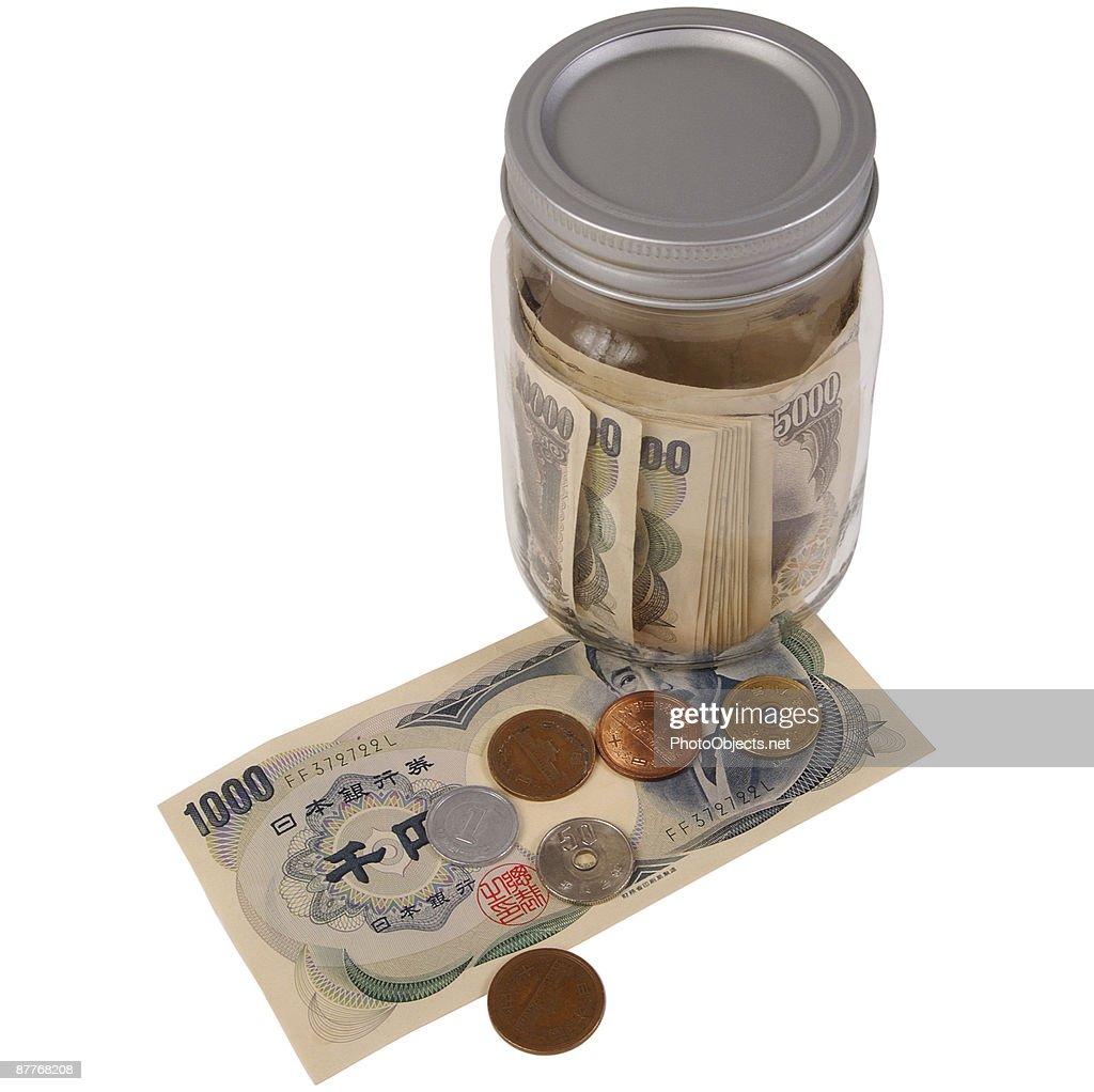 Japanese Yen With Glass Jar : Stock Photo