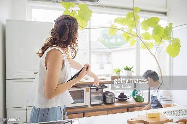 Japanese young couple cooking on holiday