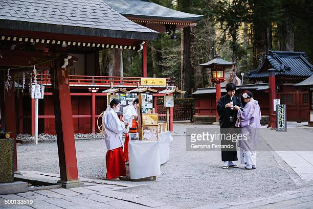 CONTENT] Japanese young couple wearing a traditional costume and opening lucky texts that bought in the temple Nikko is famous for it's World...