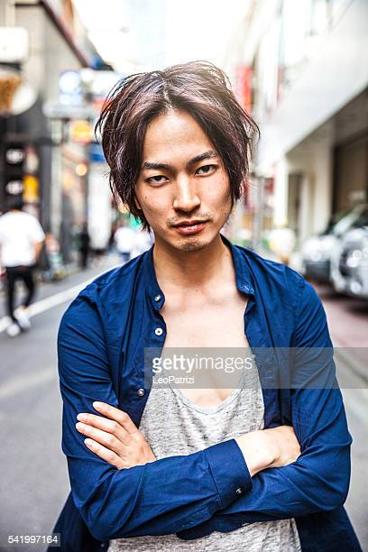 Japanese young man portrait in the street of Shibuya, Tokyo