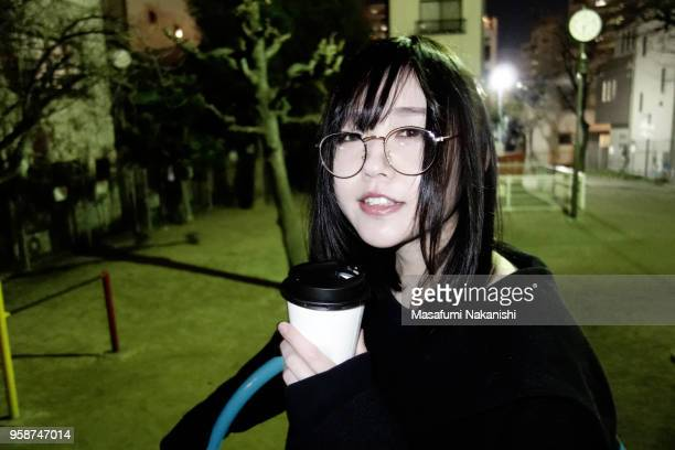 Japanese young woman drinking a coffee at night