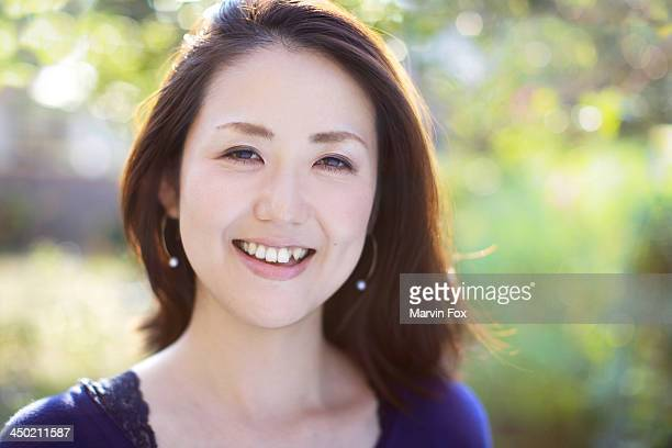 japanese young woman headshot - mid adult women stock pictures, royalty-free photos & images