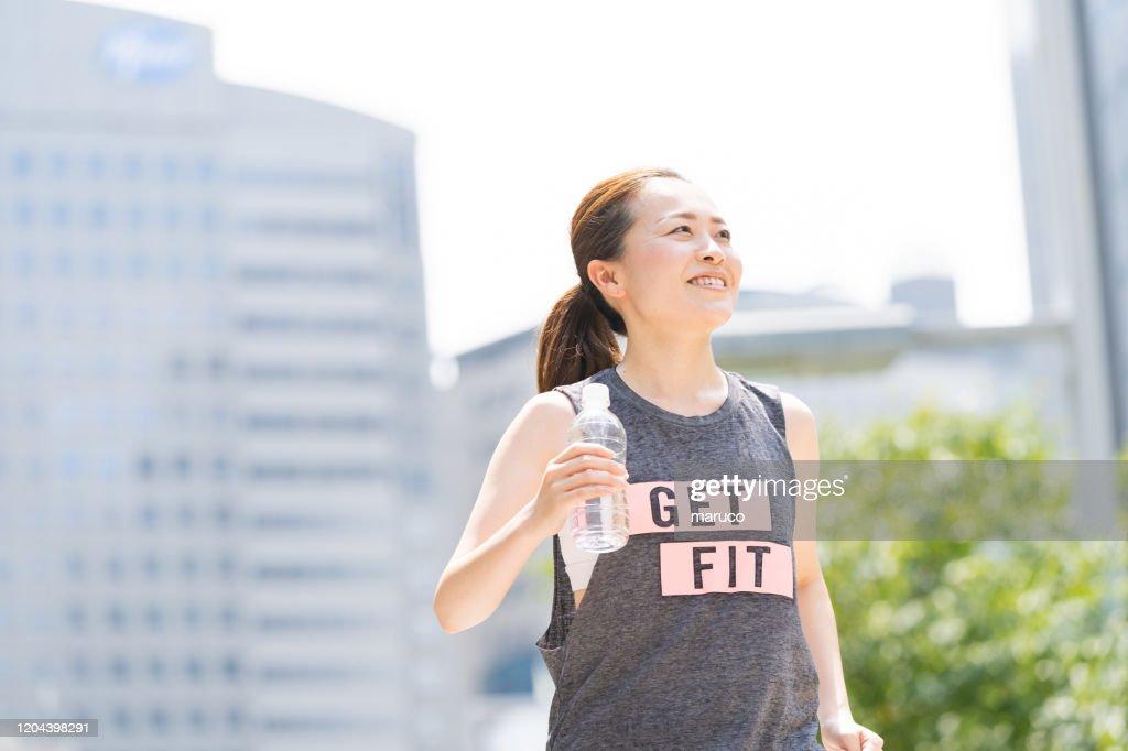 japanese young woman runs : Stock Photo
