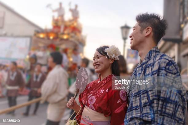 Japanese Yukata couple enjoy watching parade