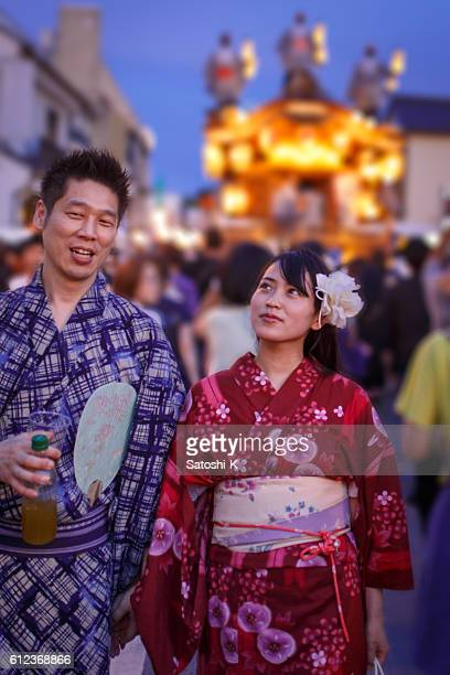 Japanese Yukata couple walking on festive street