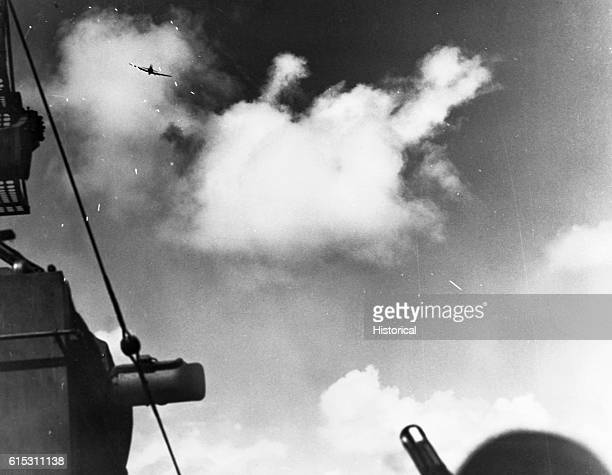 A Japanese 'zeke' comes down in a suicide dive on the USS Lexington and strikes the secondary control with the resulting bomb explosion during the...