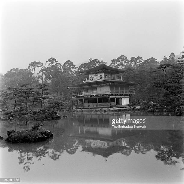 Japanese Zen Buddhist Temple Rokuonji located in Kyoto forested area on a lake with small manicured islands surrounding it Garden is styled in the...