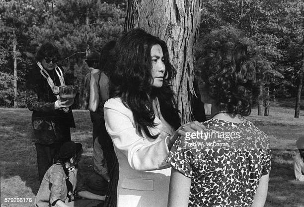 JapaneseAmerican artist and musician Yoko Ono talks with an unidentified person at a memorial 'Celebration of life' in honor of 'Action Theatre'...