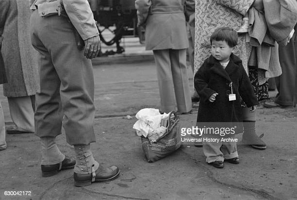 JapaneseAmerican Child During Evacuation of JapaneseAmericans from West Coast Areas under US Army War Emergency Order Los Angeles California USA...