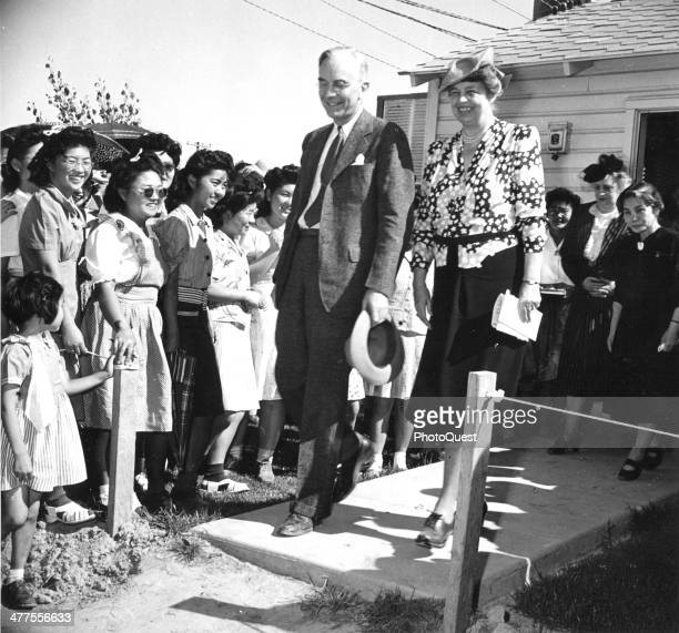 JapaneseAmerican internees at the Gila River Relocation Center greet First Lady Eleanor Roosevelt and Dillon S Myer director of the War Relocation...