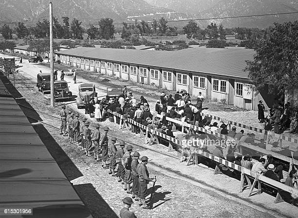 JapaneseAmerican internees waiting for registration at the Santa Anita reception center in Los Angeles County California JapaneseAmericans were...