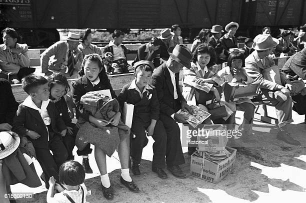 JapaneseAmerican internees waiting for Registration at the Santa Anita reception center in Los Angeles California JapaneseAmericans were evacuated...