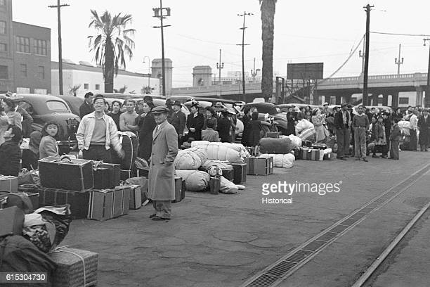 JapaneseAmericans in Los Angeles California waiting for the train to take them to Owens Valley internment camp JapaneseAmericans were evacuated from...