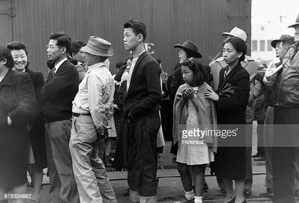 JapaneseAmericans in Los Angeles California watching a train take their friends and relatives to the Owens Valley internment camp JapaneseAmericans...