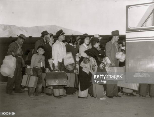 JapaneseAmericans transferring from train to bus at Lone Pine California bound for war relocation authority center at Manzanar