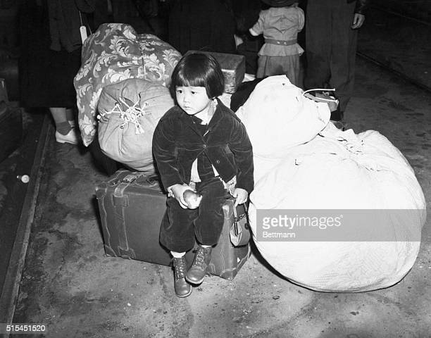 JapaneseAmericans wait with their luggage to be transported to internment camps for the duration of WWII