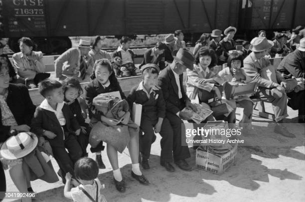 JapaneseAmericans Waiting for Registration at Reception Center During Evacuation of JapaneseAmericans from West Coast Areas under US Army War...