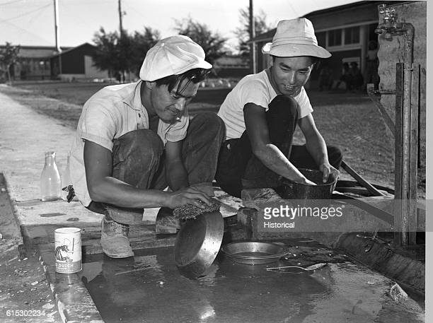 JapaneseAmericans washing dishes in a Twin Falls Idaho Farm Security Administration labor camp