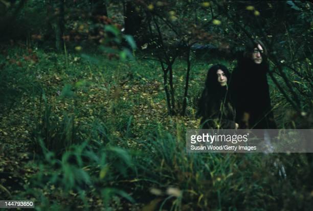 Japaneseborn artist and musician Yoko Ono and British musican and artist John Lennon walk outdoors December 1968