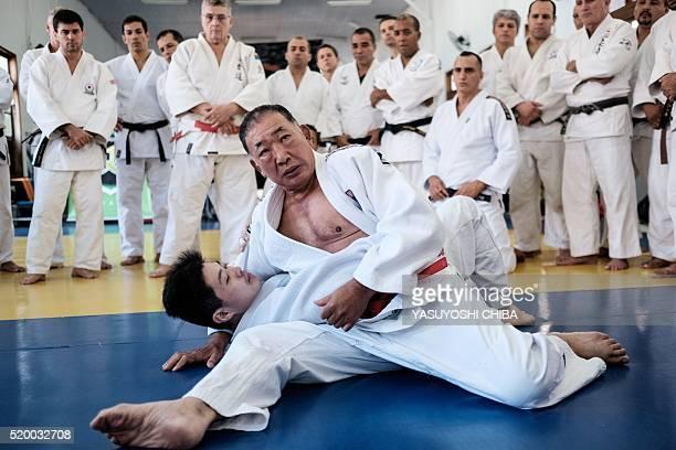 JapaneseBrazilian Judoka and Olympic bronze medalist Chiaki Ishii gives a lesson at Rio de Janeiro's Riot Police Headquaters in Rio de Janeiro Brazil...