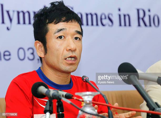 JapaneseCambodian comedian Hiroshi Neko speaks at a press conference in Phnom Penh on June 3 2016 Neko who will represent Cambodia in the men's...