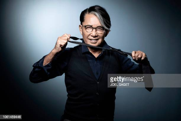 TOPSHOT JapaneseFrench fashion designer Kenzo Takada poses during a photo session in Paris on November 14 2018
