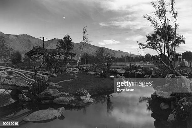 Japanesestyle garden with pool at dusk with mountains in the background and moon Ansel Easton Adams was an American photographer best known for his...