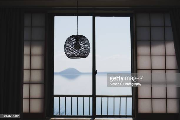 Japanese-styled window overlooking a mountain from distance