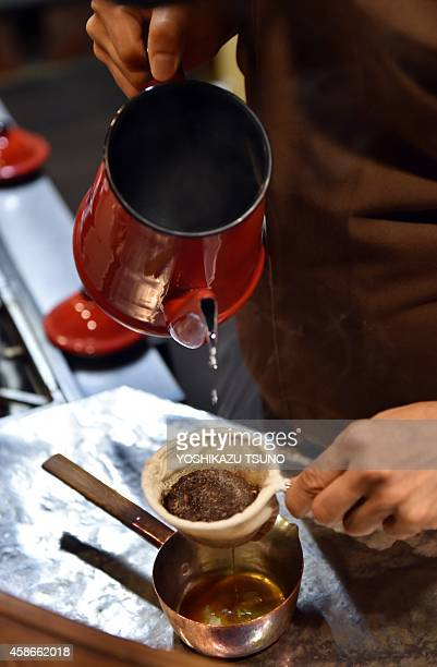 JapanlifestyleleisurecoffeeFEATURE This picture taken on October 8 2014 shows a barista of coffee shop Cafe de L'Ambre brewing a cup of coffee in...
