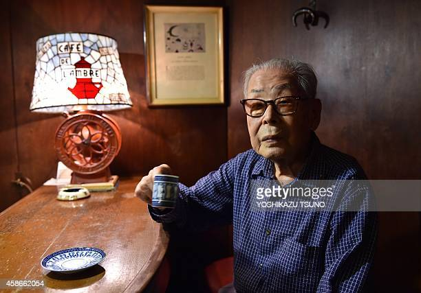 Japan-lifestyle-leisure-coffee,FEATURE BY KATIE FORSTER This picture taken on October 8, 2014 shows 100-year-old coffeeshop owner Ichiro Sekiguchi...