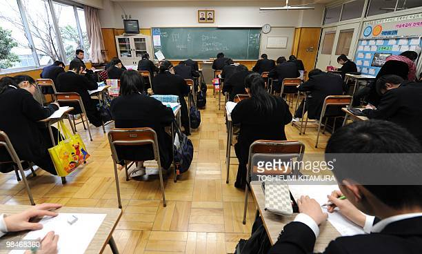 STORY 'JapanNKoreaeducationpolitics'FOCUS BY KYOKO HASEGAWA This picture taken on March 10 2010 shows students attending a mathmatics class...