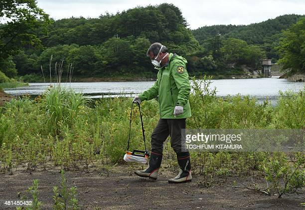 JapannuclearenvironmentenergyFOCUS by Natsuko Fukue This photo taken on July 17 2015 shows Greenpeace researcher Shaun Burnie checking radiation...