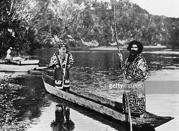 Two Ainu men in dugout canoe Undated photograph