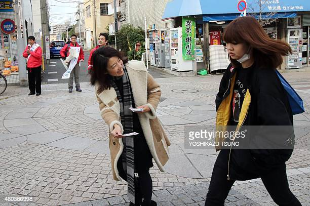 JapanpoliticsvotewomenFOCUS This picture taken on December 12 2014 shows Miki Seta a member of the Ikereru Joshikai gives a flyer of an opposition...