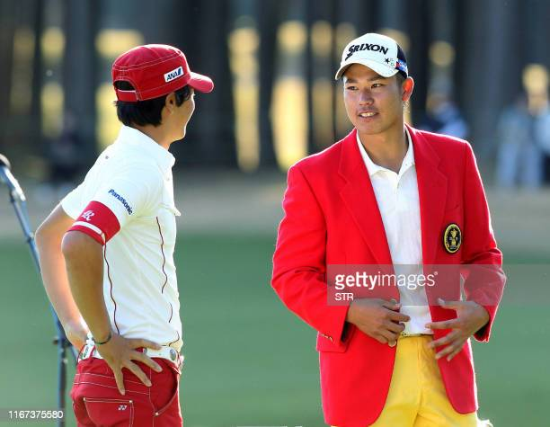 Japan's 19-year-old amateur golfer Hideki Matsuyama chats with teenaged professional golfer Ryo Ishikawa after he won the Taiheiyo Masters golf...