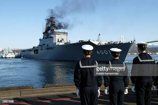 Japan's 8,900-ton Maritime Self-Defense Force supply ship Oosumi leaves Muroran port escorted by the 4,550-ton destroyer Murasame bound for Kuwait...