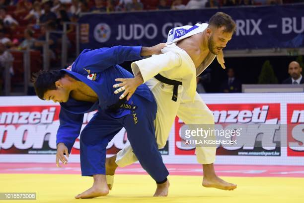 Japan's Aaron Wolf fights with Germany's KarlRichard Frey during the final bout of the Men 100kg category of the Judo Grand Prix at Papp Laszlo Arena...