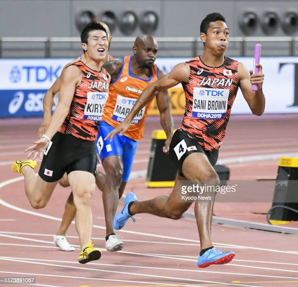 Japan's Abdul Hakim Sani Brown sprints after receiving the baton from Yoshihide Kiryu in the men's 4x100-meter relay final at the athletics world...