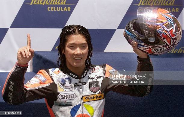 Japan's Abe Norick of Yamaha D'Antin celebrates his victory in the 500cc category at the Brazilian Grand Prix 24 October 1999 in Rio de Janeiro AFP...