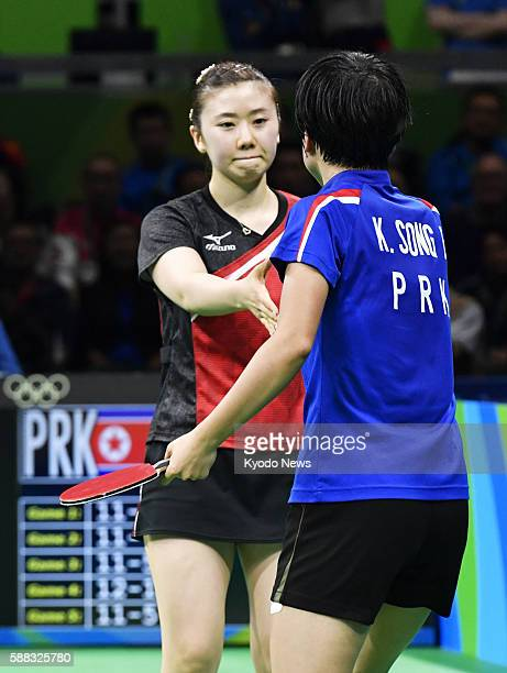 Japan's Ai Fukuhara and North Korea's Kim Song I shake hands after their singles bronze medal match of the Rio Olympic table tennis competition on...