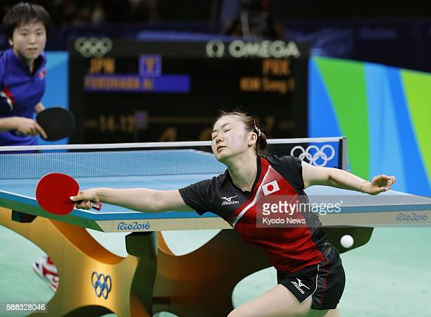 Japan's Ai Fukuhara reacts after losing a point during the women's singles bronze medal match against North Korea's Kim Song I at the Rio de Janeiro...