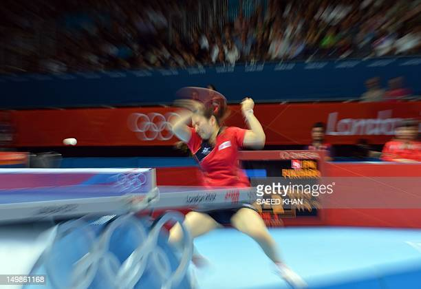 Japan's Ai Fukuhara returns to Singapore's Feng Tianwei during a table tennis women's team quarterfinal match of the London 2012 Olympic Games at the...