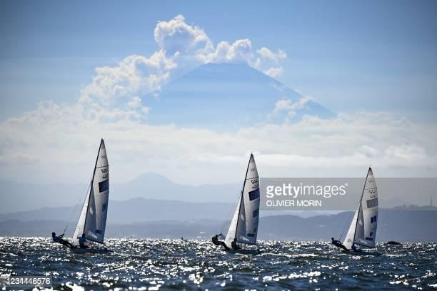 Japan's Ai Yoshida and Miho Yoshioka, Britain's Hannah Mills and Eilidh Mcintyre and France's Aloise Retornaz and France's Camille Lecointre sail...